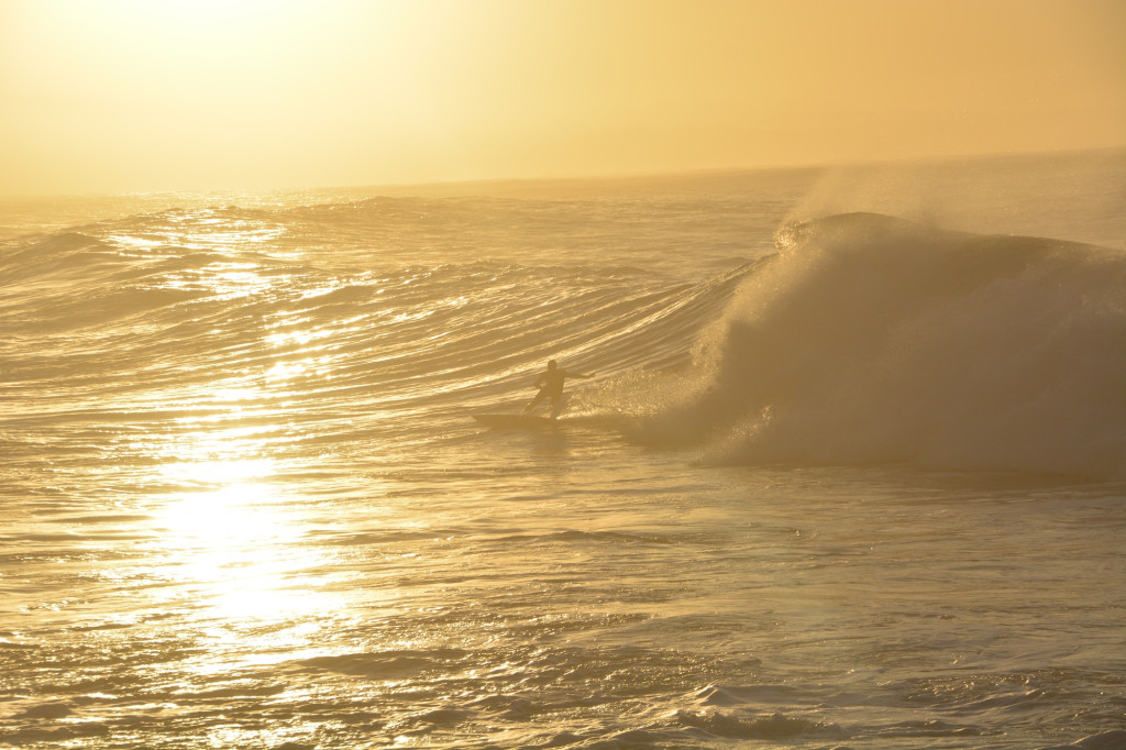 Staffan out in the waves at sunrise, Victoria's Bay