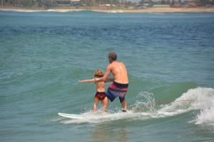 Tandem surfing with Pappa (this is the easy part) in Arugam bay