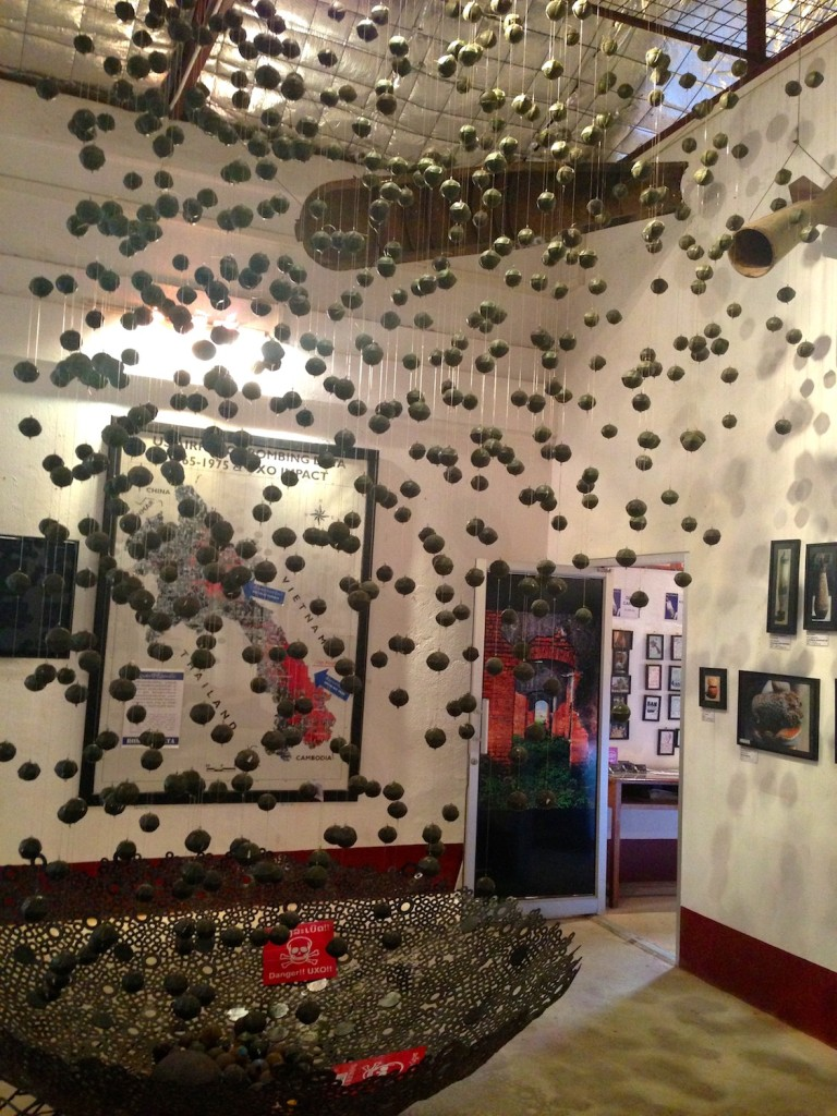 "COPE center, Vientiane.  A display showing the ""bombes"" ejected from a bomb mid-air to cover an area of multiple football fields.  Of the 80 million remaining undetonated, over 1million have been cleared over the past 10 years through painstaking efforts."