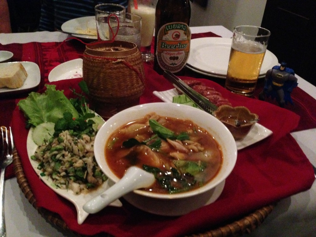 Larb, fish stew, Lao sausage, sticky rice, and Lao beer in Luang Prabang