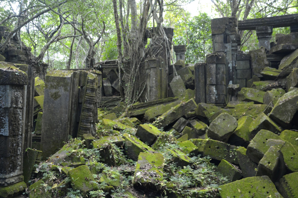 The main courtyard at Beng Mealea, a yard of crumbled ruins with an ethereal green glow from the moss.