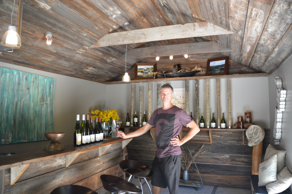 The tasting room at Pyramid Valley. The arrangement in the background shows the soil of the different vineyards.